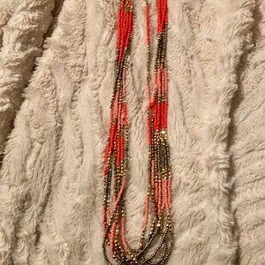 Multi strand coral, peach, gold necklace